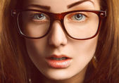 Horizontal portrait of caucasian woman in glasses — Stock Photo