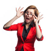 Surprised business woman in red jacket — Stock Photo