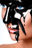 Vertical photo of sexy woman with black paint on face — Stock Photo