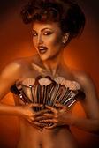 Beautiful woman smiling at camera with plurality of cosmetic nru — Stock Photo