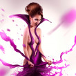 Emotical screaming adult woman in pink paint on body — Stock Photo #48260189
