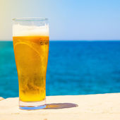 Glass of beer at summertime near sea — Stok fotoğraf