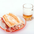 Spanish sandwich and beer — Stock Photo