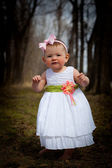 Baby in White Dress in Forest — Stock Photo