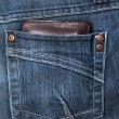 Stock Photo: Wallet in back pocket of demin pant
