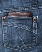 Wallet in the back pocket of a demin pant — Stock Photo