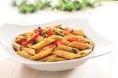 Pasta with spicy pepper sauce — Stock fotografie