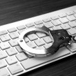 Keyboard with handcuffs — Stock Photo