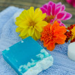 Stock Photo: Spand wellness setting with natural herbs soap and towel.