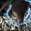 Стоковое фото: Black sexy shoe-heal with blue neckles