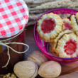 Home made raspberry jam with home made cookies — Stock Photo #13850456