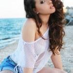 Beautiful model posing on the beach — Stock Photo #13280268