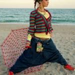 Girl with umbrella on the beach — Stock Photo