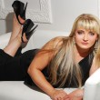 Stok fotoğraf: Beautiful blonde on the sofa