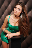 Attractive Young Woman in green dress — Stock Photo