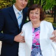Bridegroom posing with his mother — Stock Photo