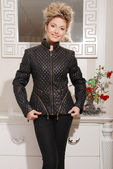 Attractive young blond woman in stylish coat — Stock Photo