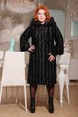 Beautiful redhead woman in fur coat — Stock Photo