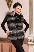 Beautiful brunette woman in fur coat — Stock Photo