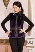 Beautiful brunette woman in fur coat — Foto de Stock