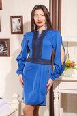 Beautiful young woman in stylish dress — Stock Photo