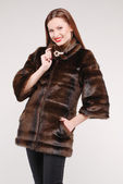 Beautiful woman in fur coat — Stock Photo