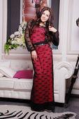Beautiful woman in fashionable stylish dress — Stock Photo
