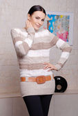 Attractive woman wearing stylish sweater — Stock Photo