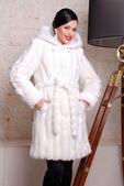 Attractive brunette woman in fur coat — Stock Photo