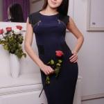 Beautiful brunette woman in fashionable stylish dress — Stock Photo #47512543