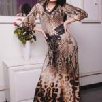 Beautiful brunette woman in fashionable stylish dress — Stock Photo #47512587