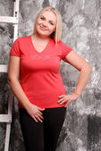 Portrait of young blond woman indoor — Stock Photo