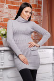 Attractive woman wearing knitted clothes — Stock Photo