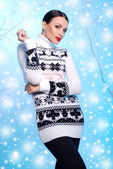 Attractive woman wearing knitted dress — Stockfoto