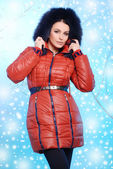 Beautiful young woman in warm winter clothes — Stock Photo