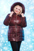 Beautiful blonde woman in winter coat with hood — Stock Photo