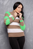 Portrait of a beautiful female model in knitted clothes — Stock Photo