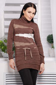 Attractive woman wearing knitted dress — Stock Photo