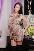 Beautiful brunette woman in fashionable stylish dress — Stockfoto