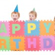 Children with happy birthday kids sign — Stock Photo #12743622