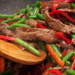 Stock Photo: Cooking beef, capsicum and bestirfry in wok