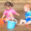 Toddler children playing on beach sand — Стоковое фото #12742389