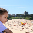 Girl overlooking crowded Coogee beach in Sydney — Стоковое фото #12742419