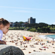 Girl looking at Coogee Beach in summer — Stock Photo #12742420