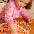 Girl child cooking homemade pizza in kitchen — Stockfoto