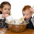 Stock Photo: Kids measuring and mixing cake in kitchen