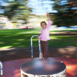 Foto Stock: Girl on moving roundabout