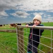 Farm boy on gate — Stock Photo