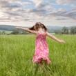 Stock Photo: Girl running through long grass