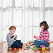 Kids playing with blocks — Stock Photo #12743327
